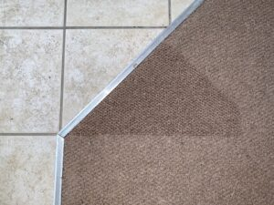 Carpet transition damage after